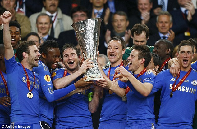 Aloft: Injured Terry helps Lampard lift the trophy at the Amsterdam ArenA