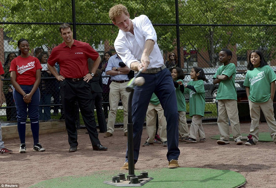 Batting practice: Prince Harry hits a baseball during the launch of a partnership between the Royal Foundation of the Duke and Duchess of Cambridge and Harlem RBI, a local community organization in New York