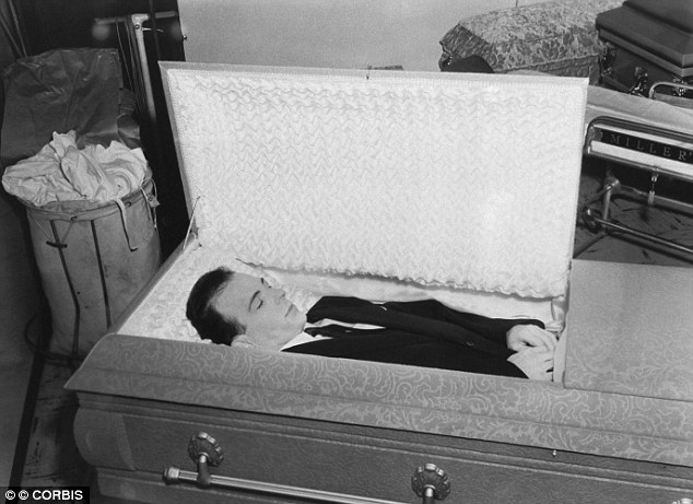 The body of Lee Harvey Oswald lies in a casket at Parkland Morgue in Dallas, Texas