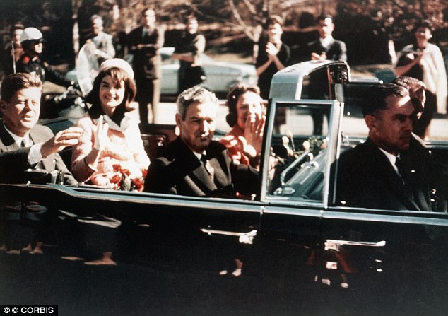 Dallas, Texas, USA --- Prior to the assassination, President John F. Kennedy, First Lady Jacqueline Kennedy, and Texas Governor John Connally ride through the streets of Dallas, Texas on November 22, 1963