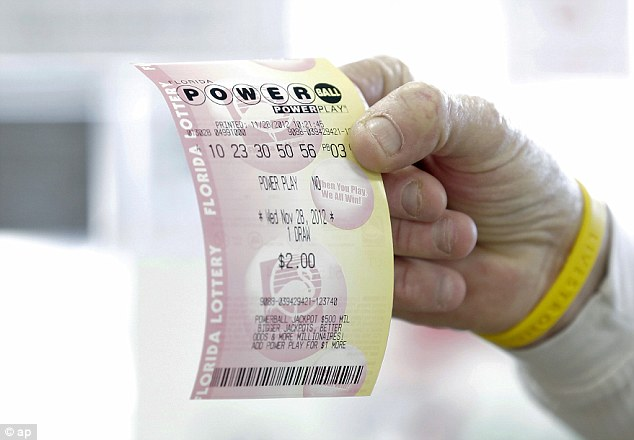 Lucky ticket: A Powerball ticket is seen in Tampa, Florida, while on Wednesday similar ticket holders will face the chance of winning an estimated $360 million jackpot