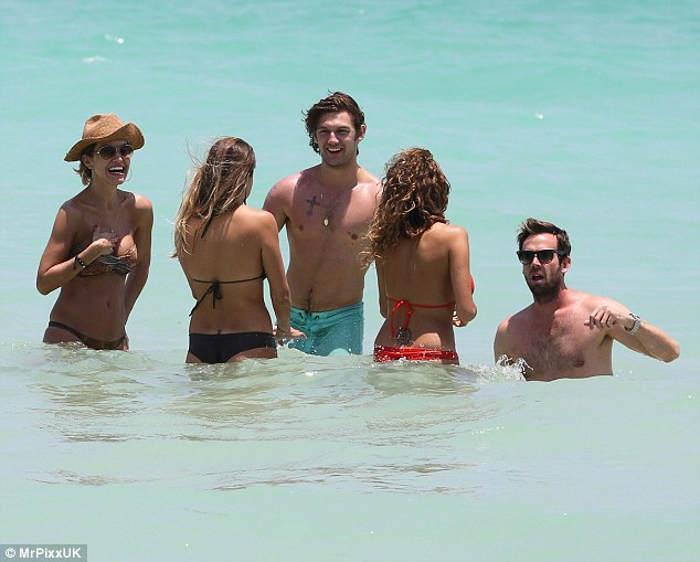 Mr Popular! Alex Pettyfer found himself surrounded by a bikini-clad bevy of beauties as he soaked up the sun in Miami, Florida
