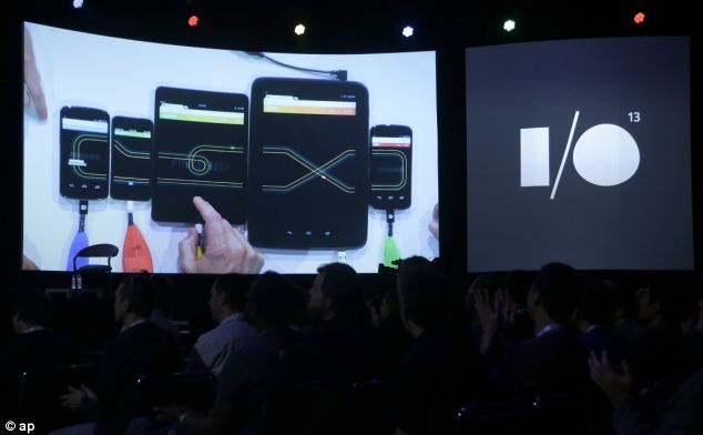 The Google Racer game is seen being played on different devices on a screen, showing off the new multiplayer features