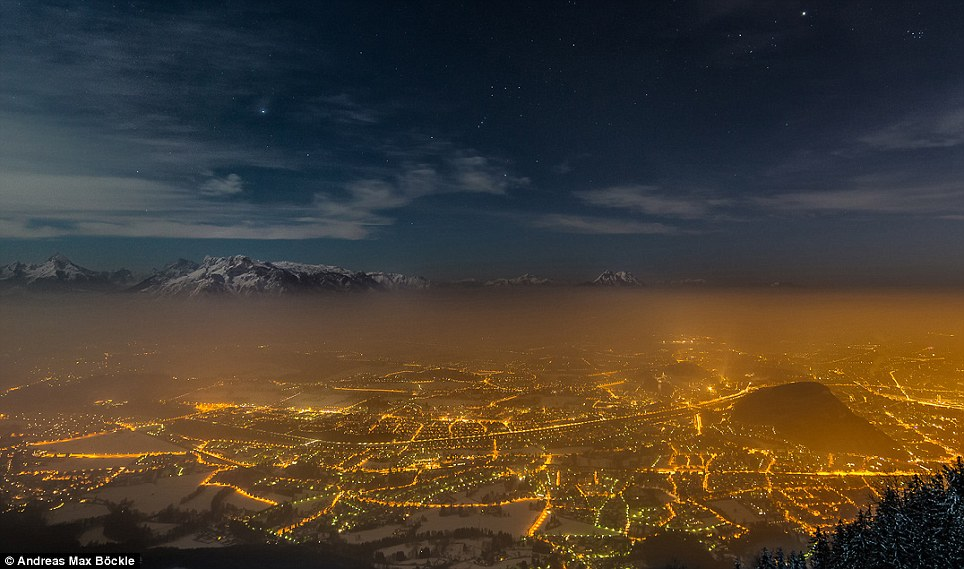 Stunning: This picture is called Stars over Salzburg and shows the glow of the Austrian city's lights from a high Alpine vantage point. The picture helps reflect concerns with light pollution