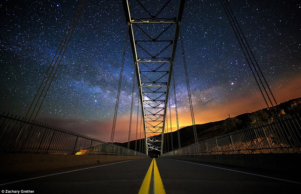 Ethereal: The night-time glow in Arizona lights up these clouds above the Roosevelt Lake Bridge