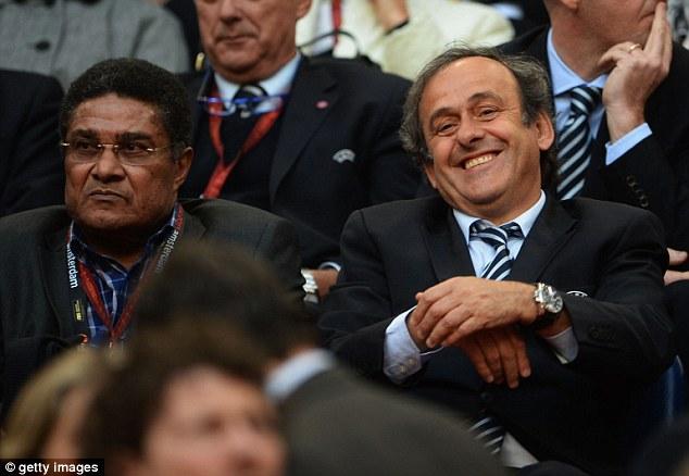 Boss: UEFA President Michel Platini enjoys himself sitting next to ex-Benfica player Eusebio