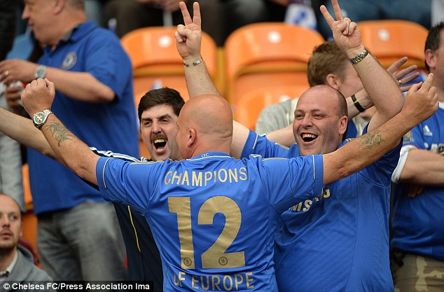 We know what we are: A Chelsea fan shows off his 'Champions of Europe' replica shirt