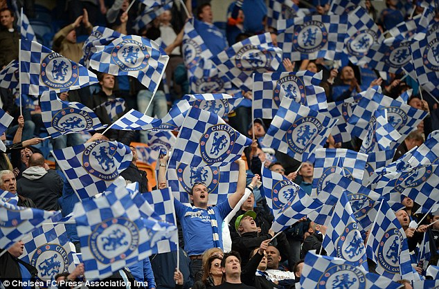 Blue is the colour: Chelsea supporters wave team flags and show their support