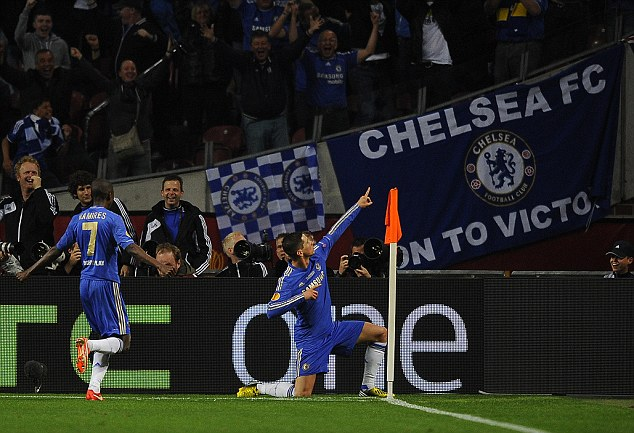 Delight: Torres celebrates his goal before being mobbed by his ecstatic team-mates