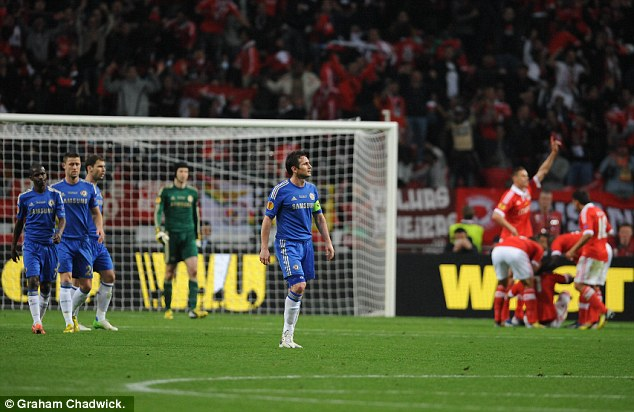 Reaction: Lampard looks on as Benfica celebrate their equaliser at the Amsterdam Arena