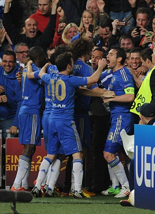 Jubilation: Chelsea celebrate Ivanovic's last-gasp goal in front of their delighted travelling fans