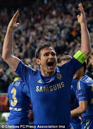 Joy: Lampard fires up the Chelsea crowd