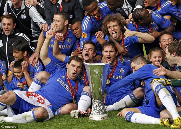 Glory: Ivanovic leads the celebrations on the pitch with the Europa League trophy