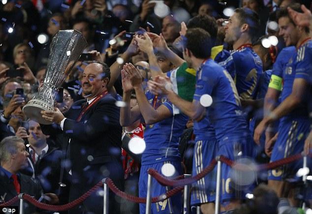 Boss: Rafa Benitez smiles as he lifts the Europa League trophy in Amsterdam