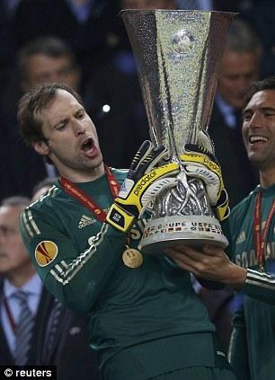 Safe hands: Petr Cech lifts the trophy