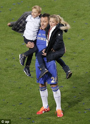 Young ones: John Terry celebrates with his children
