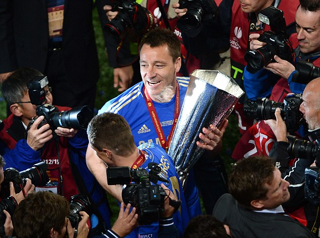 Centre of attention: Terry is mobbed by photographers in Amsterdam... much like he was in Munich last year