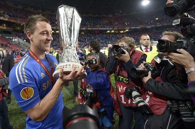 Party time: Terry leads the celebrations with his team-mates and family in Amsterdam