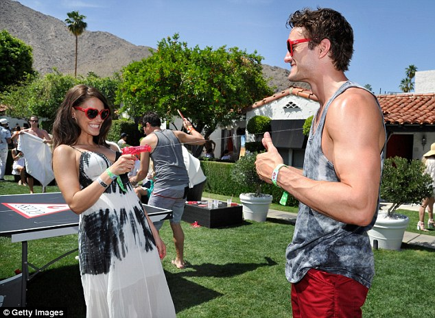 Jessica, in Guess, and boyfriend Thom Evans get wet at the label¿s poolside soirée