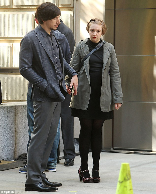 Scarlet woman: Lena Dunham wore eye catching red lipstick on the set of Girls in New York on Wednesday