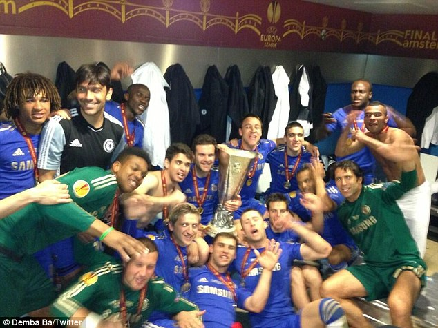 Party time: Demba Ba posted this picture of the Chelsea dressing room on Twitter