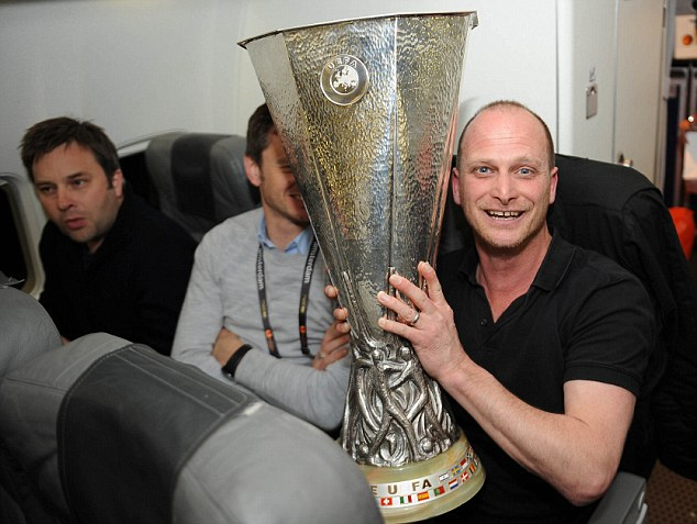 Hands on the prize: Sportsmail's Graham Chadwick holds the trophy on the flight home with Chelsea