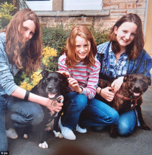 Katie Littlewood (pictured, right, with her sisters Sarah, left, and Stephanie, centre) may have been listening to her headphones at the time of the incident