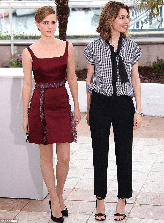 The stars of the show: Emma looked somewhat stiff as she posed next to the film's director Sofia Coppola