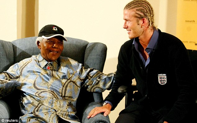 Statesman: Beckham's enormous popularity has seen him engage with some of the world's most senior figures, including a meeting with Nelson Mandela in South Africa 10 years ago