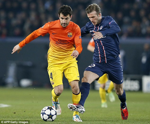 Clash: David Beckham goers toe to toe with Cesc Fabregas of Barcelona during a Champions League clash last month