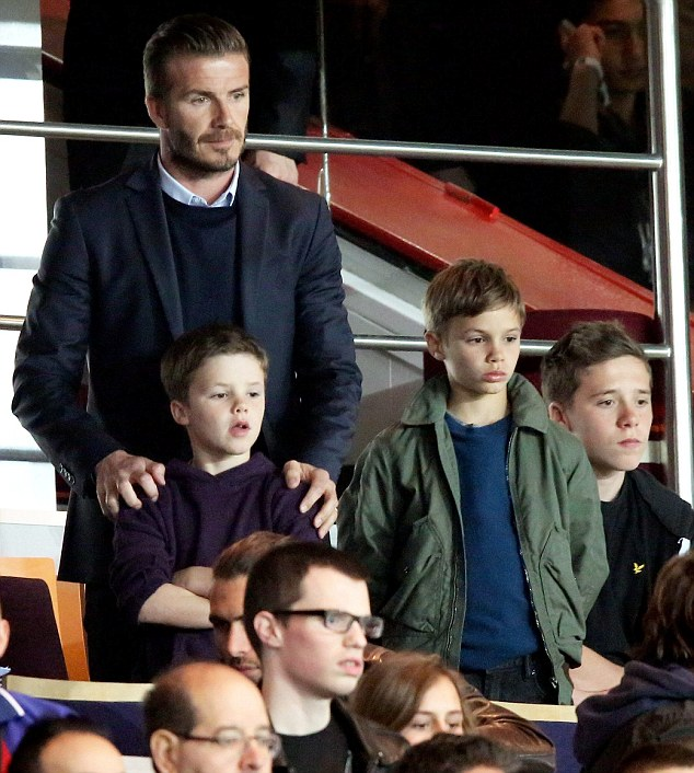 Retired: Beckham, pictured with his sons Brooklyn, Romeo and Cruz at a recent Paris Saint Germain home game will retire at the end of the season