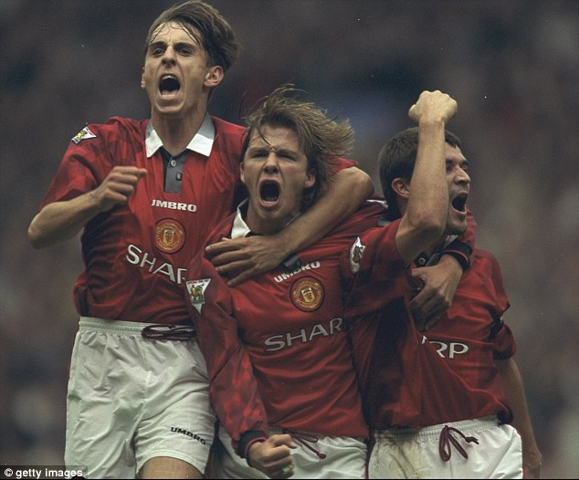 Delight: David Beckham, centre, celebrates with Gary Neville (left) and Roy Keane after Manchester United scored against West Ham in a Premier League match