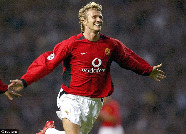 First club: David Beckham celebrates scoring for Manchester United in a Champions League qualifying match in 2002