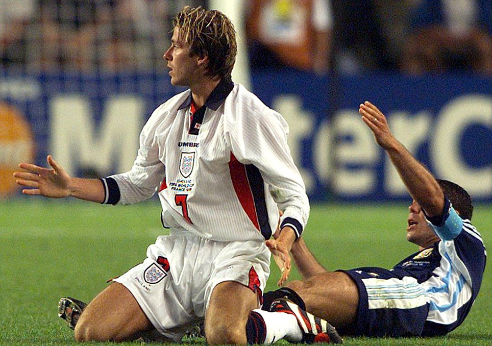 Lowest ebb: In a sporting sense, that is - Beckham and his curtains are sent off for kicking out at Diego Simeone of Argentina at France '98