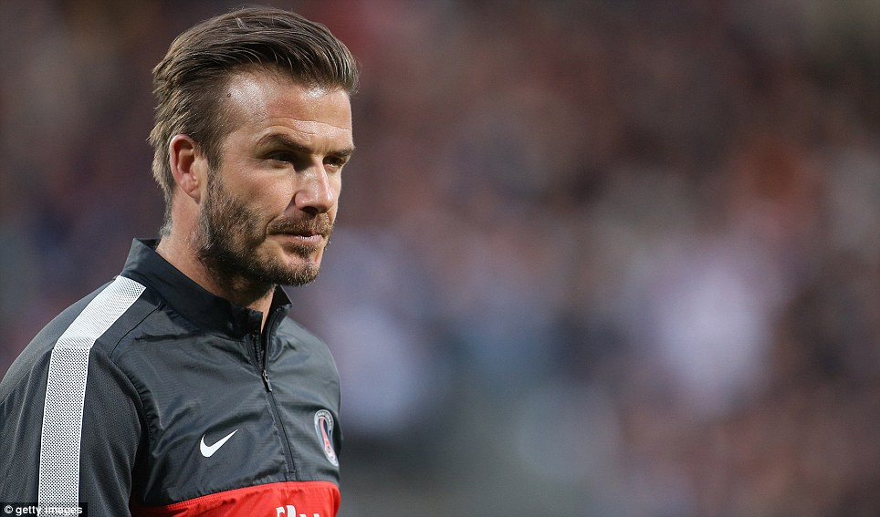 Classy to the end: David Beckham is to retire from football, having won the Ligue 1 title with Paris Saint-Germain