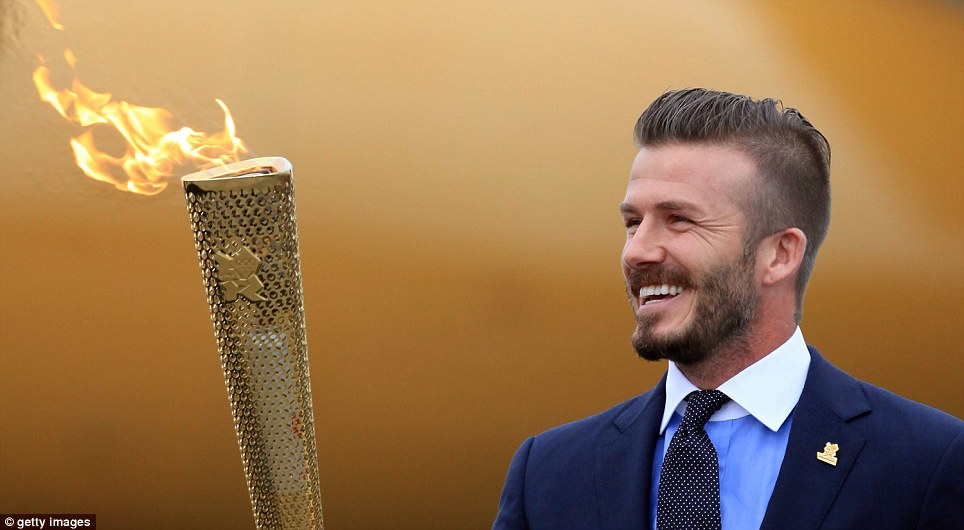 Ambassador: Beckham with the Olympic flame having played such a pivotal role in bring the Games to London in 2012