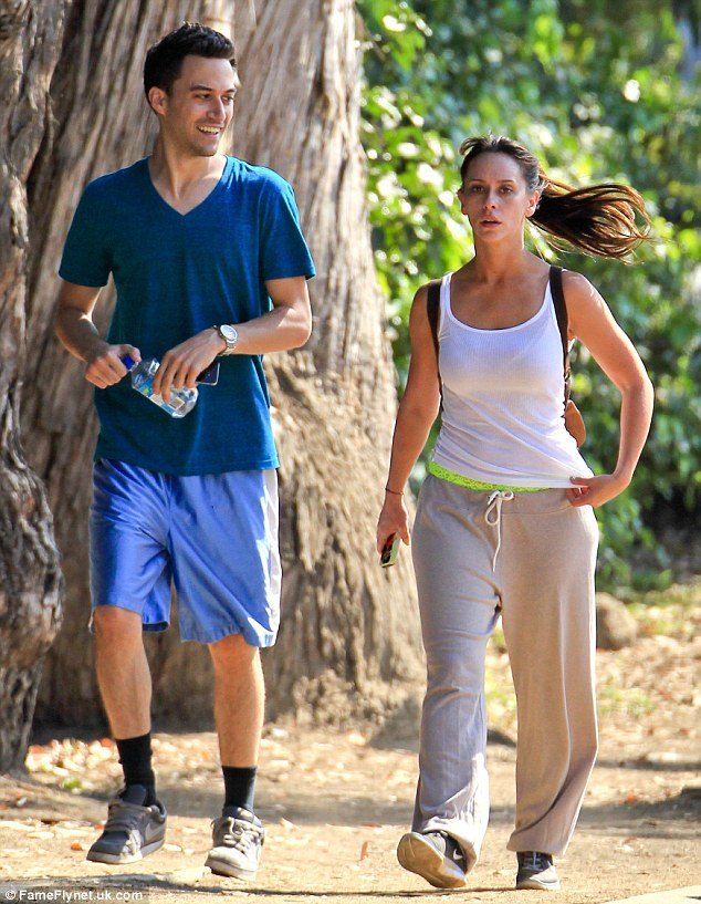 The man she loves: Jennifer fell for Brian on the set of their Showtime series The Client List, and were seen here enjoying a hike in L.A. in August