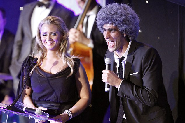 Centre of attention: Fellaini's 'fro went down a treat at Everton's end-of-season awards bash