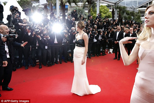 Back shot: She ensured all angles of her Chanel gown were snapped before she headed into the event