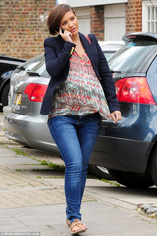 Pregnancy is treating her well: The 24-year-old singer teamed the loose-fitting blouse with a pair of jeans and a blazer