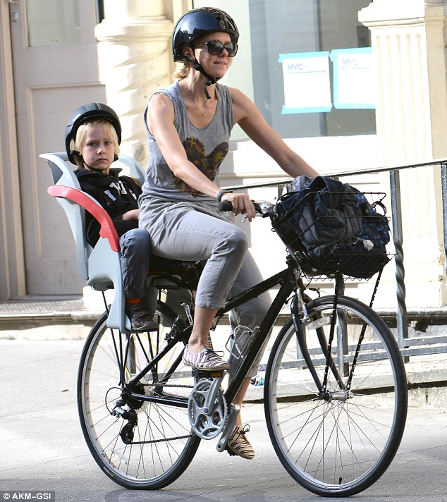Safety first: The duo sported matching shiny, black helmets