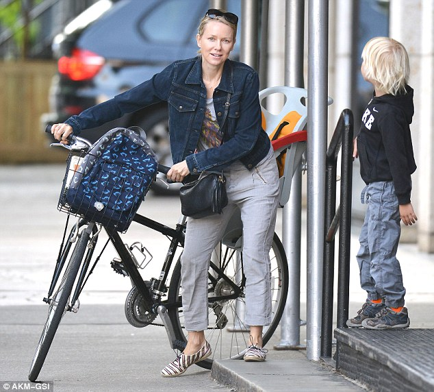 All aboard... Naomi rode the bike, as a child seat remained in the back from Sasha to lounge on