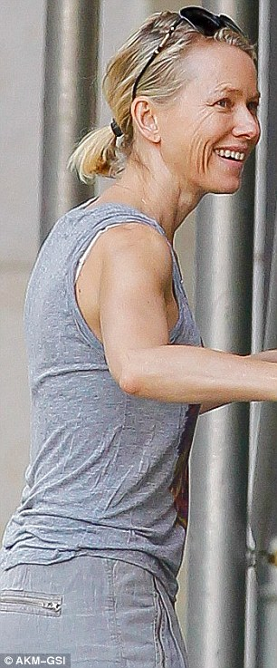 Comfortable cycling gear: The blonde beauty donned a sheer grey tank top and complimentary loose-fitted trousers