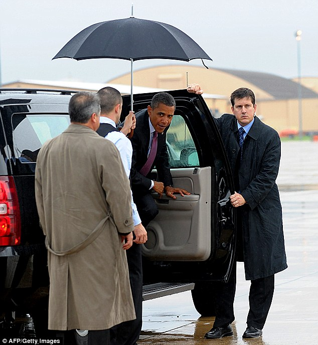 Keeping dry: Many different individuals have held umbrellas for the commander in chief