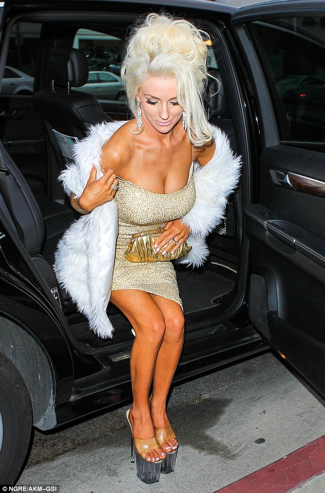 Close call! The blonde reality star seemed to have a little trouble climbing out of the car, almost tumbling out of her gold dress