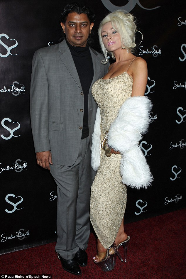 Oops, where's Doug? Courtney Stodden posed seductively with Shekhar Rahate on the red carpet prior to the event