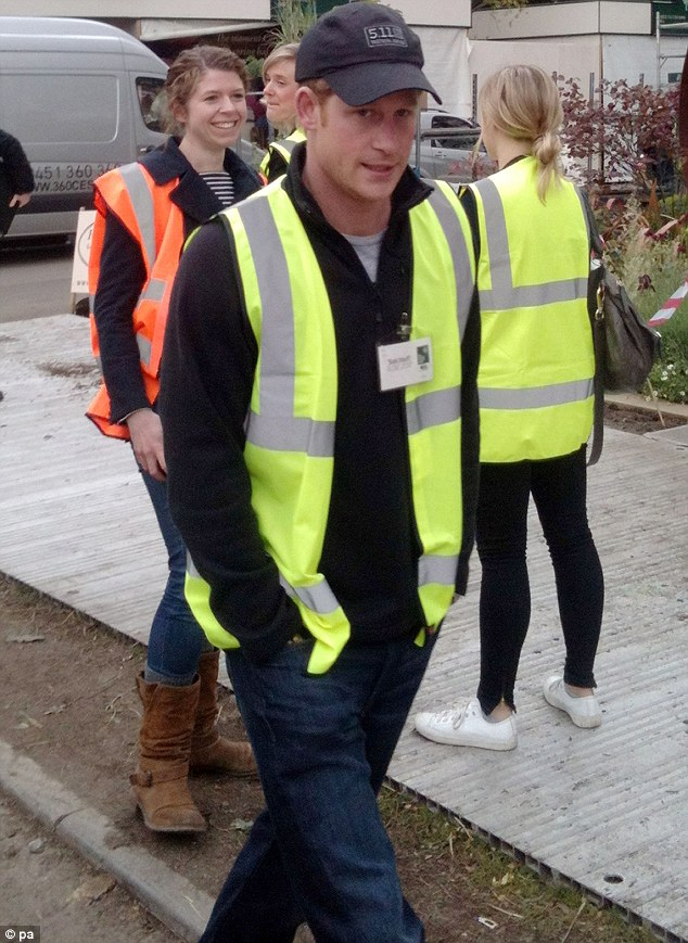 Casually dressed: The Prince wore jeans, a baseball cap and high vis jacket as he made a surprise visit to the Chelsea Flower Show