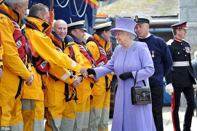 Lovely in lilac: Her majesty greets the crew of RNLB The Princess Royal