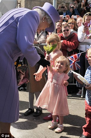 For you: The Queen was handed flowers by well-wishing little girls