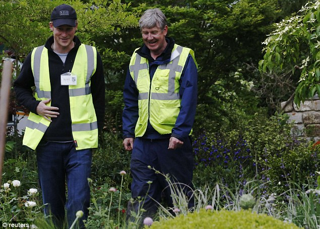 Easy to talk to: Designer Roger Platts said he was delighted to give Harry a tour of the M&G Centenary garden